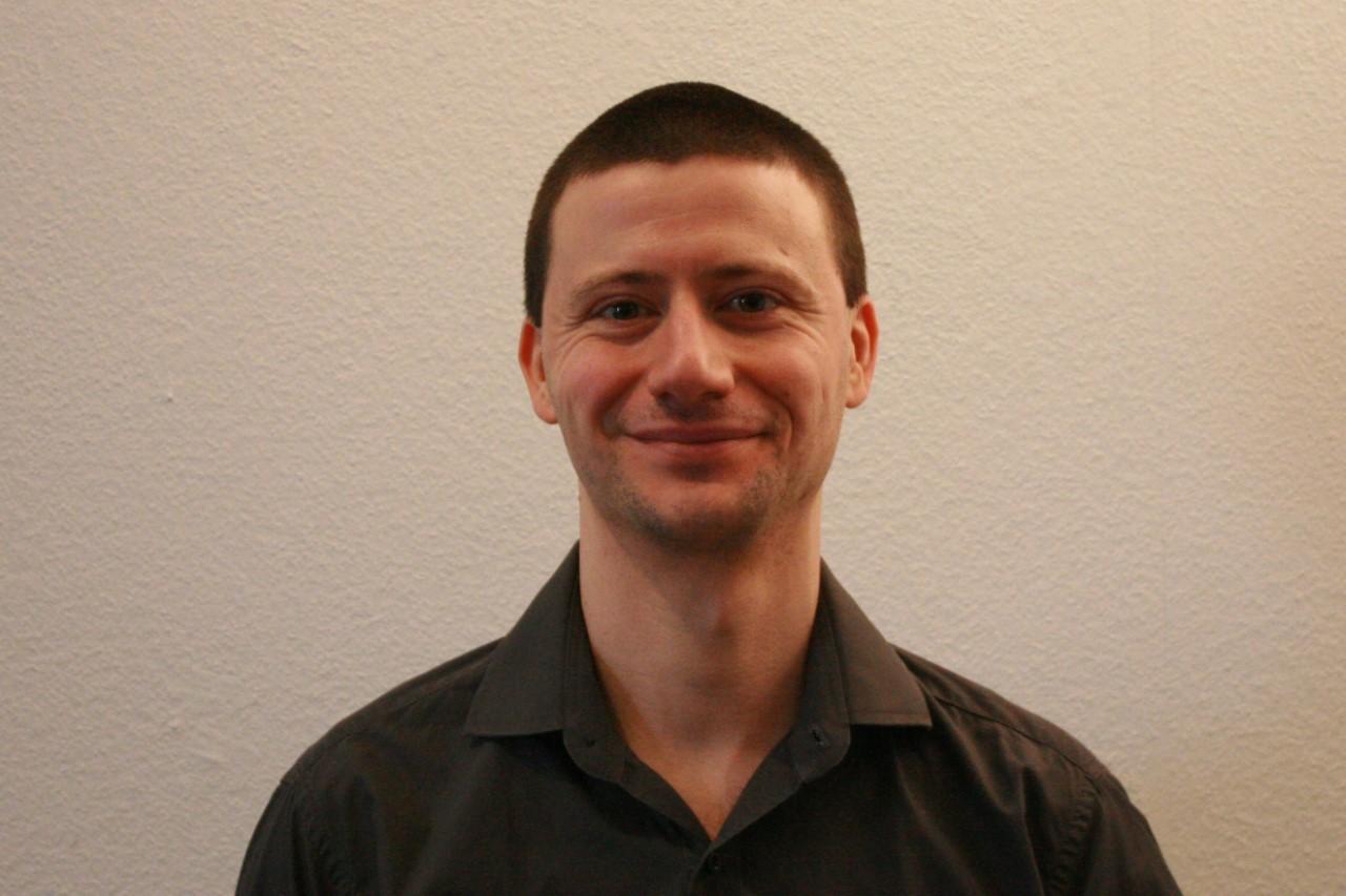 Porträt Dr. Markus Kolm.